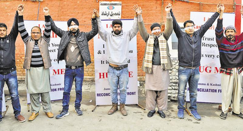 Blindfolded Kashmiri Pandit Hugs It Out To Promote Brotherhood In Valley