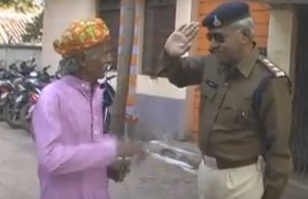 Police Inspector Sets Example By Asking A Sweeper To Hoist Flag For Republic Day