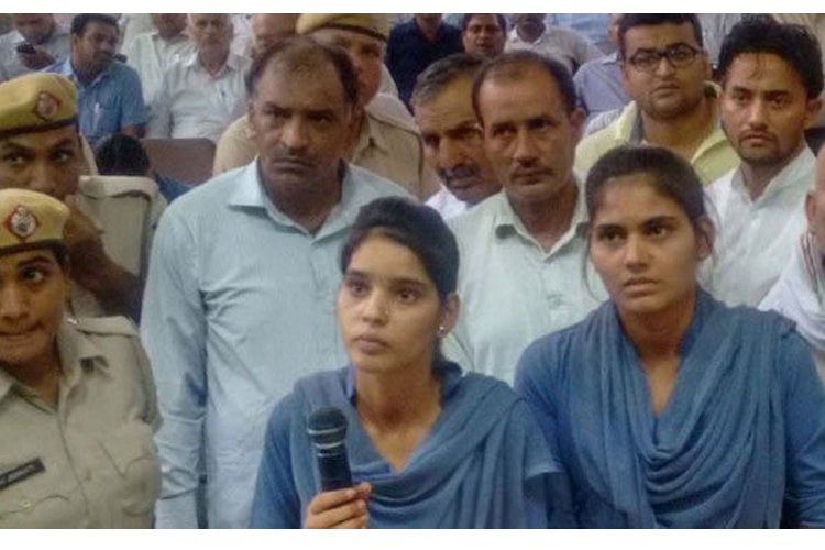 At A State Ministers Public Meeting, Two Girls Complain Of Groping & Molestation By A Party Leaders Son