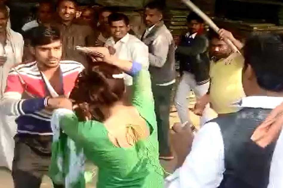 [Video] UP: Woman Brutally Beaten For Resisting Molestation In Crowded Market, While Public Watched & Filmed The Incident