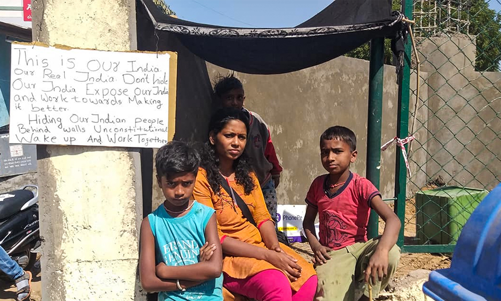 Ill Be Right Here When Trump Passes: Activist On Hunger Strike Against Wall Built To Conceal Slum