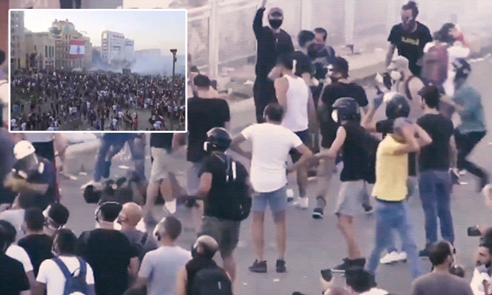 Beirut: Police Fire Tear Gas As Anti-Government Demonstrations Continue For Second Day After Port Explosion