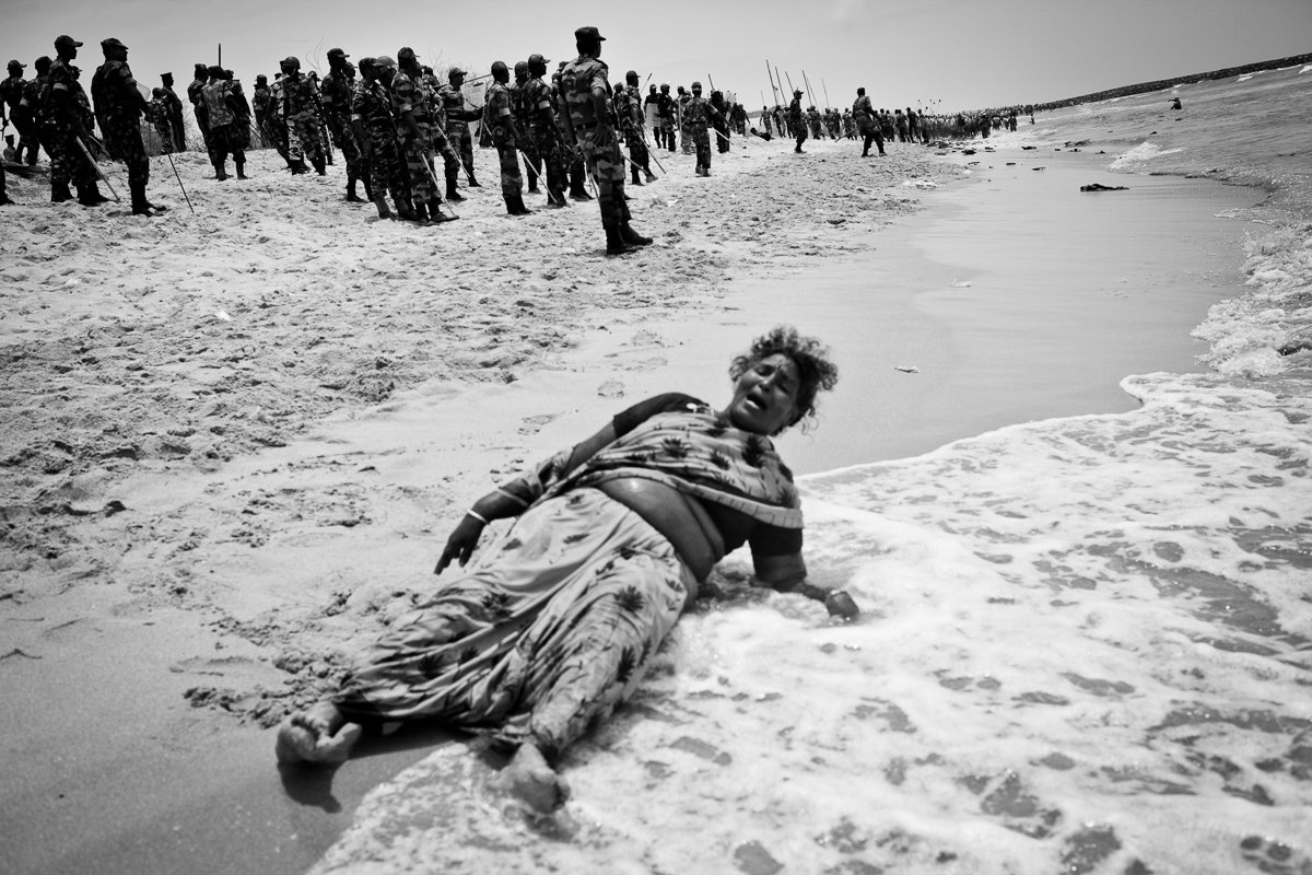 Xavieramma, a resident of Idinthakarai, cries out for help after being chased into the sea with no place to run. She was later helped out and arrested by the security forces. She has been charged with 16 cases including serious charges like sedition and waging war against the nation.